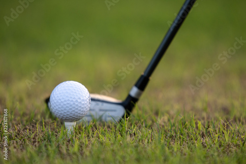 Fotografia, Obraz  Three metal wood at rest behind teed-up golf ball providing  copy space for text or graphics