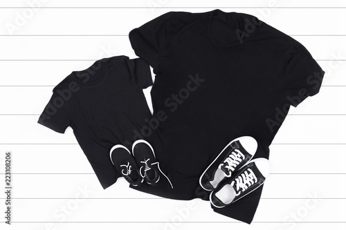 Child and adult black t-shirt on a white background