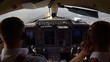 senior pilot and copilot are sitting in a small cabin of civil airplane and controlling flight