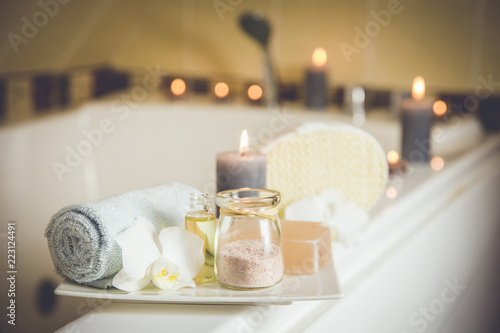 Billede på lærred White ceramic tray with home spa supplies in home bathroom for relaxing rituals