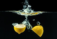 Fresh Yellow Lemon In Water Sp...