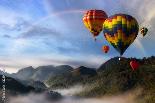 Keuken foto achterwand Ballon Hot air balloons with landscape mountain.