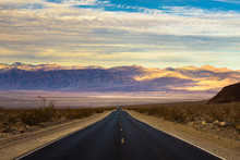 Empty Road Running Through Dea...