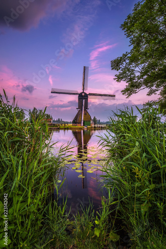 Old dutch windmill at sunset in Kinderdijk