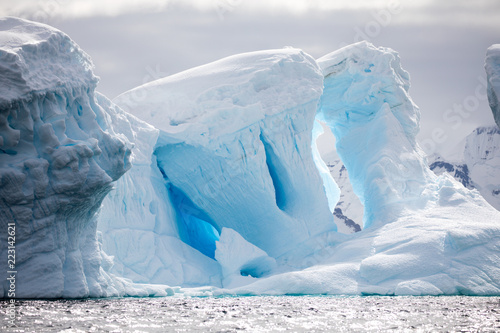 ice in the Antarctica with iceberg in the ocean