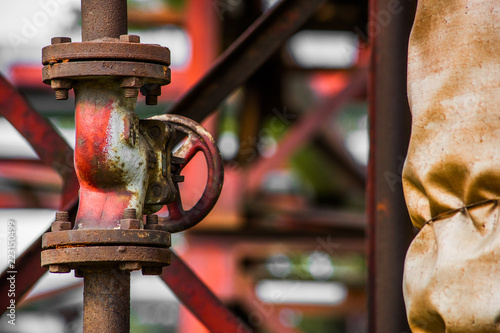 Photo  Valve on industrial pipes