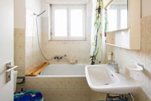 Vintage Bathroom With Green Tiles And Window