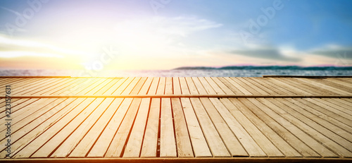 Summer sunset with landscape of sea and wooden pier with free space for your decoration.