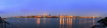 Beautiful Cityscape Panorama Of The Skyline Of Antwerp, Belgium, During The Blue Hour Seen From The Shore Of The River Scheldt