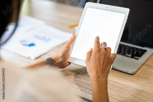 Lifestyle with modern woman using tablet or Ipad with hand holding touchscreen. Hands of working woman with Smart Tablet reading online website . Business Concept