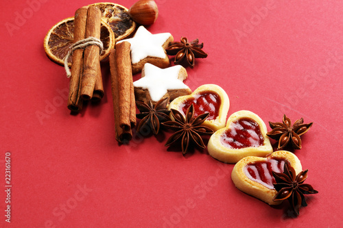 Baking christmas cookies. Typical cinnamon stars bakery with spices. xmas decoration