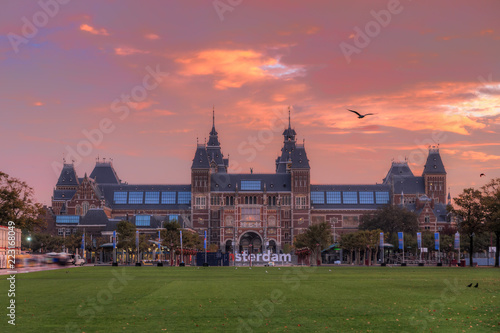 Amazing vibrant sunrise at the Museum Square (Museumplein) in Amsterdam, The Netherlands, looking towards the beautiful National State museum (Rijksmuseum)