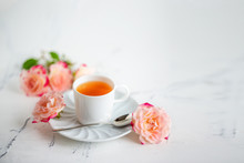 Cup Of Tea With Roses On A Light Background