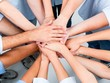 Top View of People in Circle with Their Hands Together