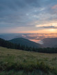 Carpathians landscape in august, west Ukraine. Sundown in mountains at summer. Ukrainian nature background. The sky covered with grey clouds illuminated by the sun. Blurred background