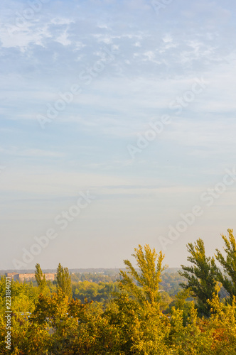 Autumn landscape with colorful trees in sunlight