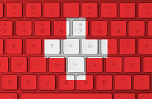 Swiss Flag And Computer Keyboard In The Background. Switzerland Flag