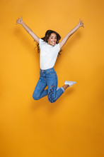 Full Length Portrait Of A Cheerful Girl With Long Dark Hair