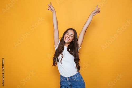 Fotografiet  Portrait of a joyful young girl with long brunette hair