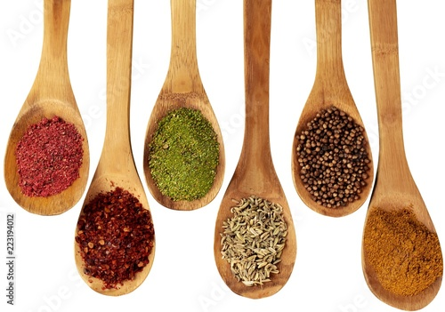 Spices On Wooden Spoons - Isolated