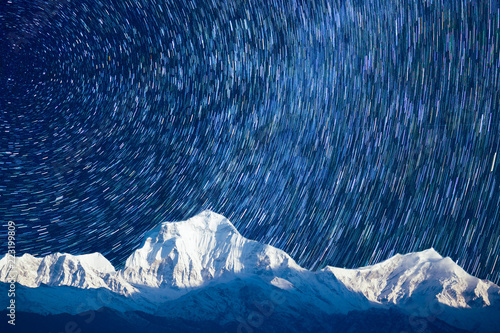 Keuken foto achterwand Nachtblauw starry sky with mountains in Iceland on long endurance. TimeLapse Concept