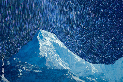 Foto op Aluminium Nachtblauw starry sky with mountains in Iceland on long endurance. TimeLapse Concept