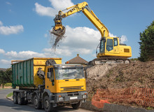 360 Excavator Loading Site Clearance Materials Into A Disposal Lorry