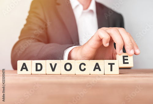 Man made word ADVOCATE with wood blocks Canvas Print