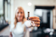 Woman Holding A Usb Key. Focus On A Foreground, On The Usb.