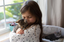 A Girl Holding Kittens.
