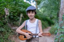 Portrait Of A Boy With A Mandolin.