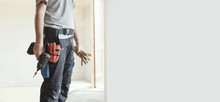 Professional Repairman Standing And Holding A Drill