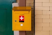 Yellow Mailbox Swiss Postal Service Mounted On A Brick Wall