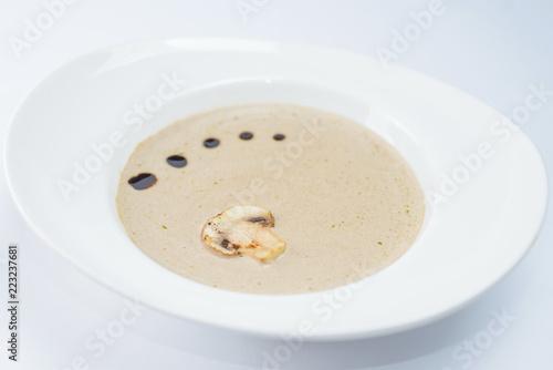 Fotografie, Obraz  mushroom cream soup in a white plate