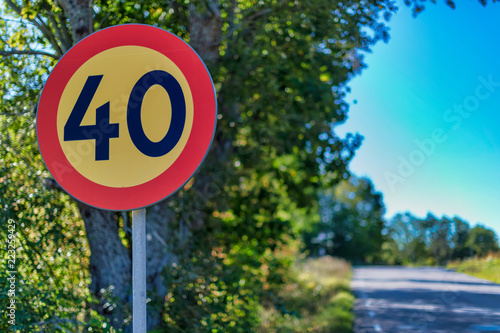 Fotomural  Traffic sign in limiting the speed to 40 kph at the road