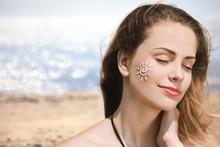 Beautiful Woman With Sunscreen...