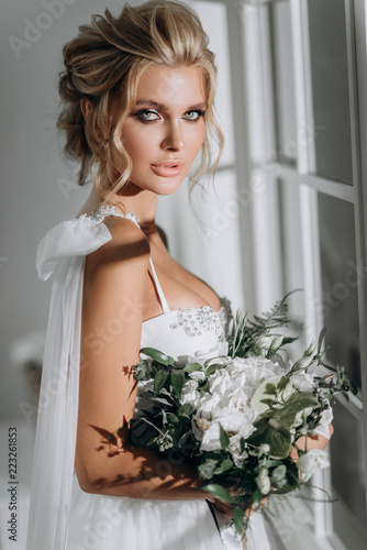 beautiful sexy young blond woman in bath with rose petals Fototapeta