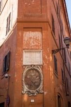 Sculpture On And Painting On A Street Corner In Rome, Italy
