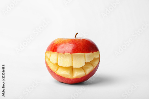 Funny smiling apple on white background