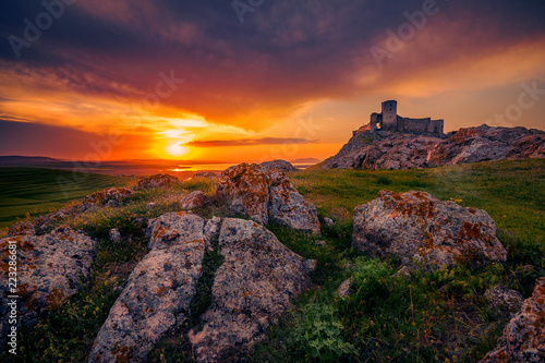 Recess Fitting Ruins Old ruined citadel on a rocky hill shot at sunset with some rocks in the foreground