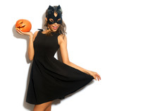Happy Young Women In Little Black Dress With Halloween Pumpkin And In Cat Mask Over White Background