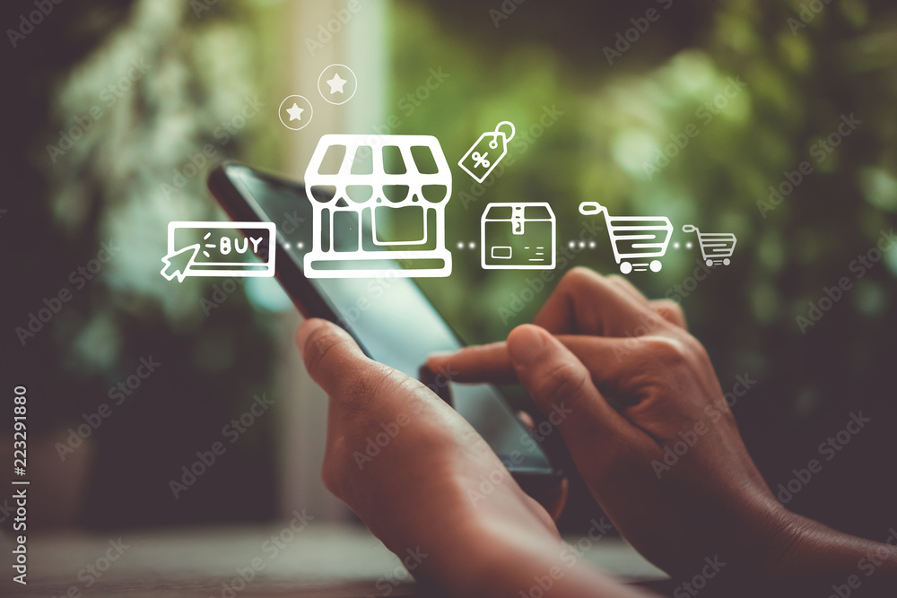 Fototapeta Women hand using smartphone do online selling for people shopping online with chat box, cart, dollar icons pop up. Social media maketing concept.