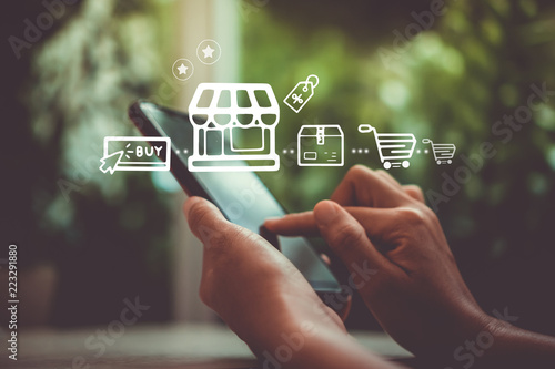 Fotografía Women hand using smartphone do online selling for people shopping online with chat box, cart, dollar icons pop up