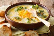 Spicy Thick Creamy Broccoli Cheese Soup In A Bowl With Toast Close-up. Horizontal
