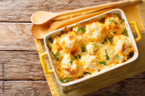 Vegetable casserole from cauliflower with cheese, eggs and cream close-up in a baking dish. Horizontal top view