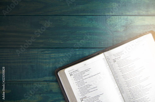 Holy Bible on a Blue Wooden Table Out for Studying