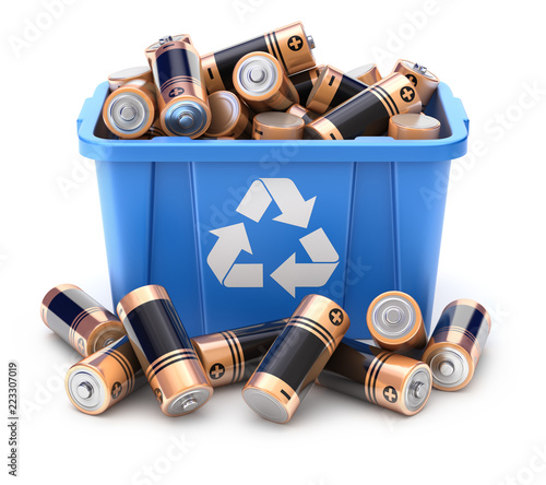 Obraz na plátně Batteries in blue recycle crate on white background