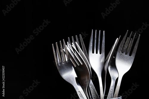 Fotografie, Obraz  Lot of metal cutlery on a black background