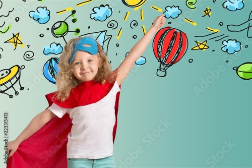 Photo  Cute Child in superhero costume on background