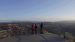 Tourists on the overlook at Bryce Point during sunrise.